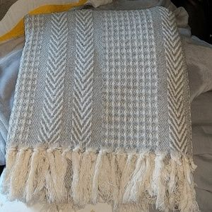Gray and cream colored throw blanket
